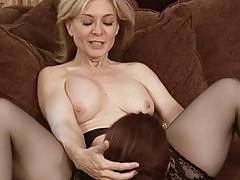Busty MILF Nina Hartley plays wiht younger babe in these hardcore sapphic video clips