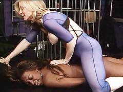 Brunette babe Nina Hartley teaches ebony beauty Naomi Banxxx the joys of some light lesbian bondage